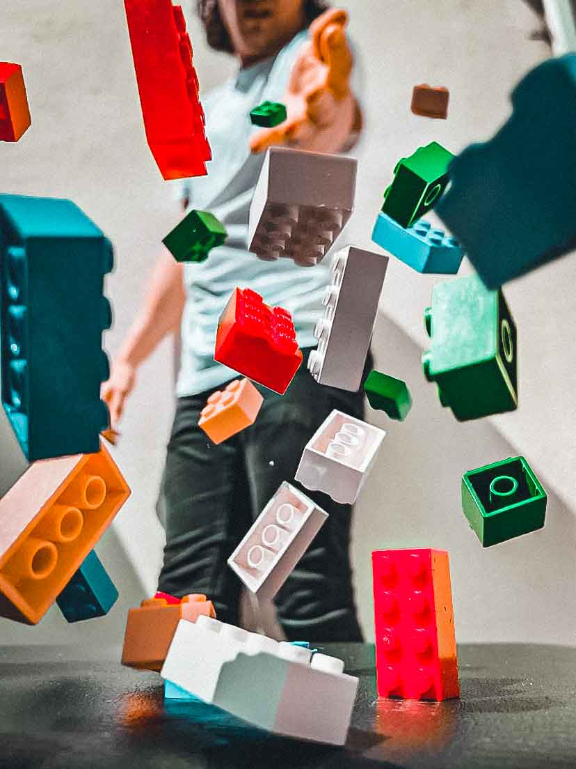 Photograph of Lego pieces in the air